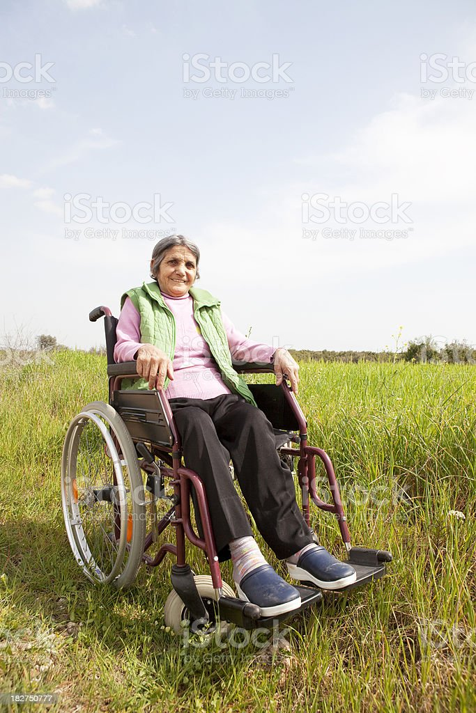 Senior woman in wheelchair royalty-free stock photo