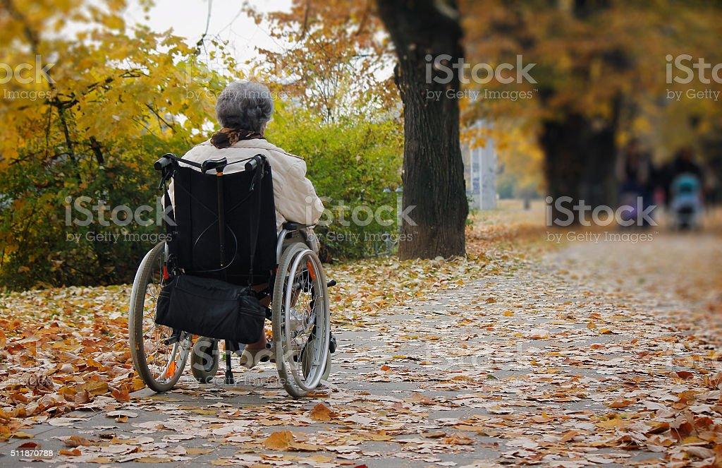 Senior woman in wheelchair stock photo
