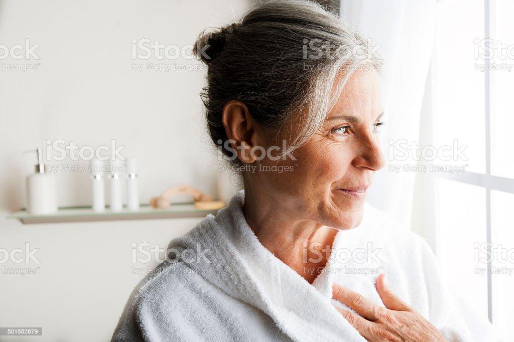 Senior Woman In White Bathrobe stock photo