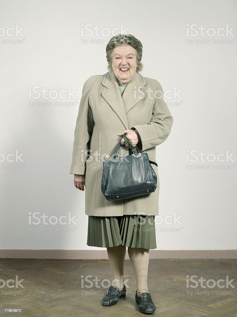 Senior woman in winter clothes stock photo
