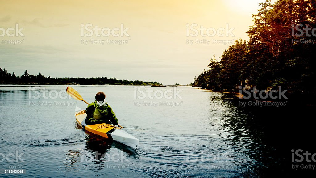 Senior Woman Kayaking stock photo