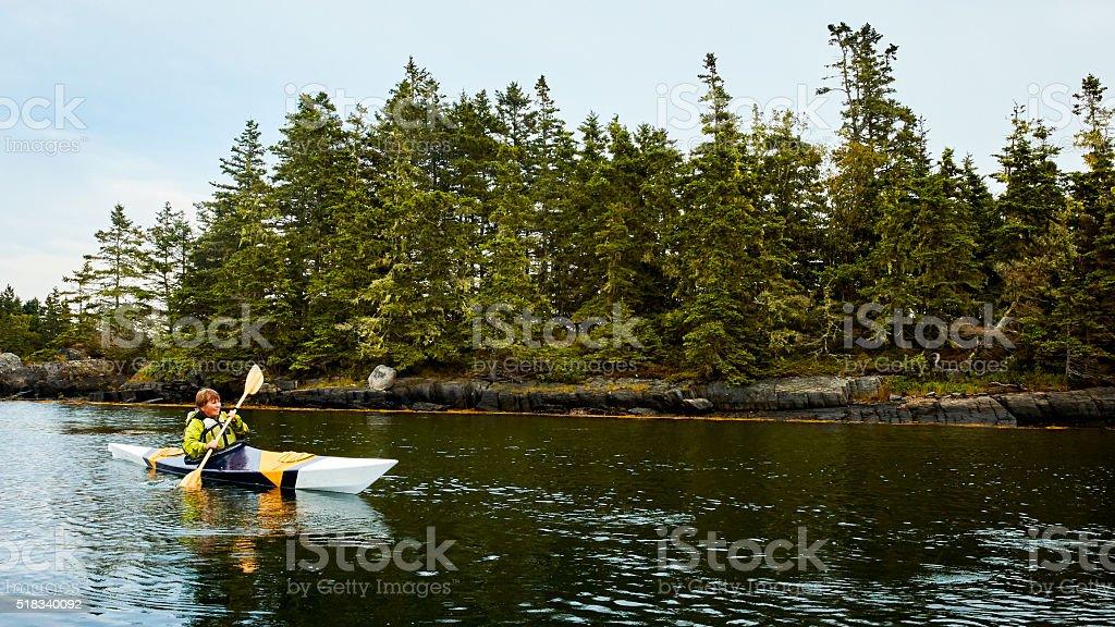 Senior Woman Kayaking stock photo