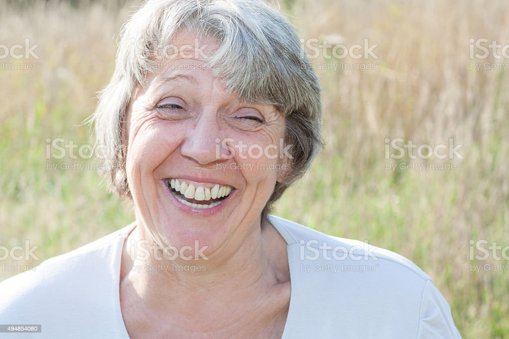 Senior woman laughing out loud stock photo