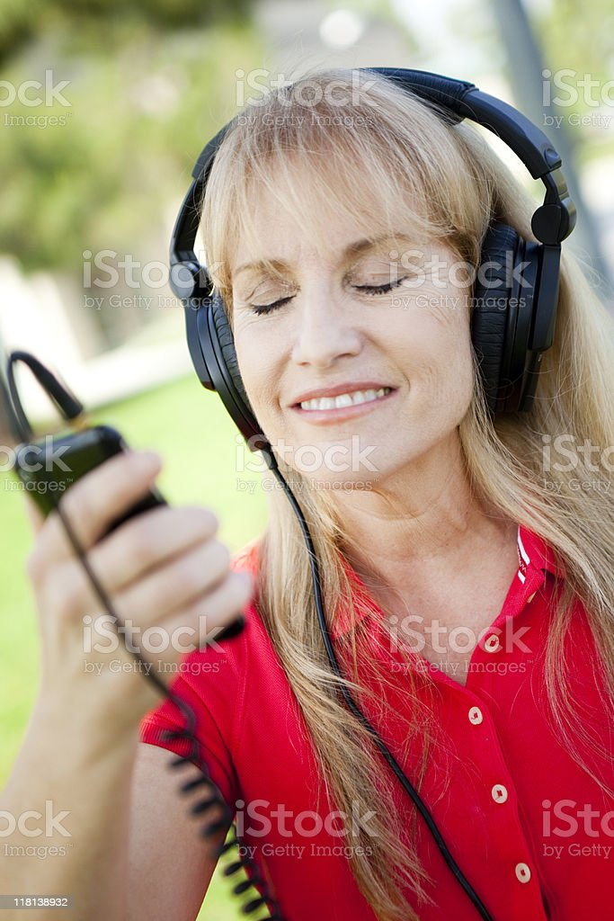 Senior Woman Listening to Music stock photo
