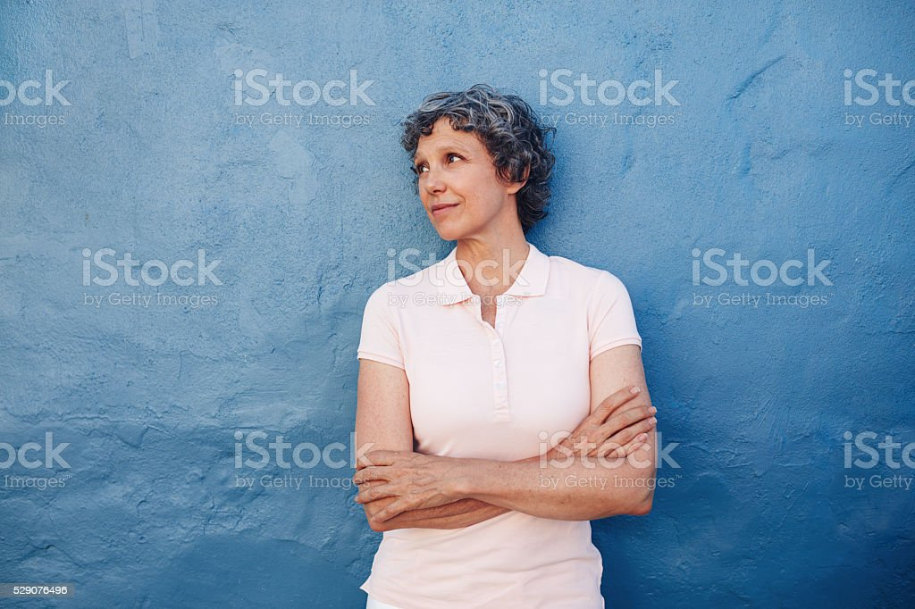 Senior woman looking at copy space stock photo