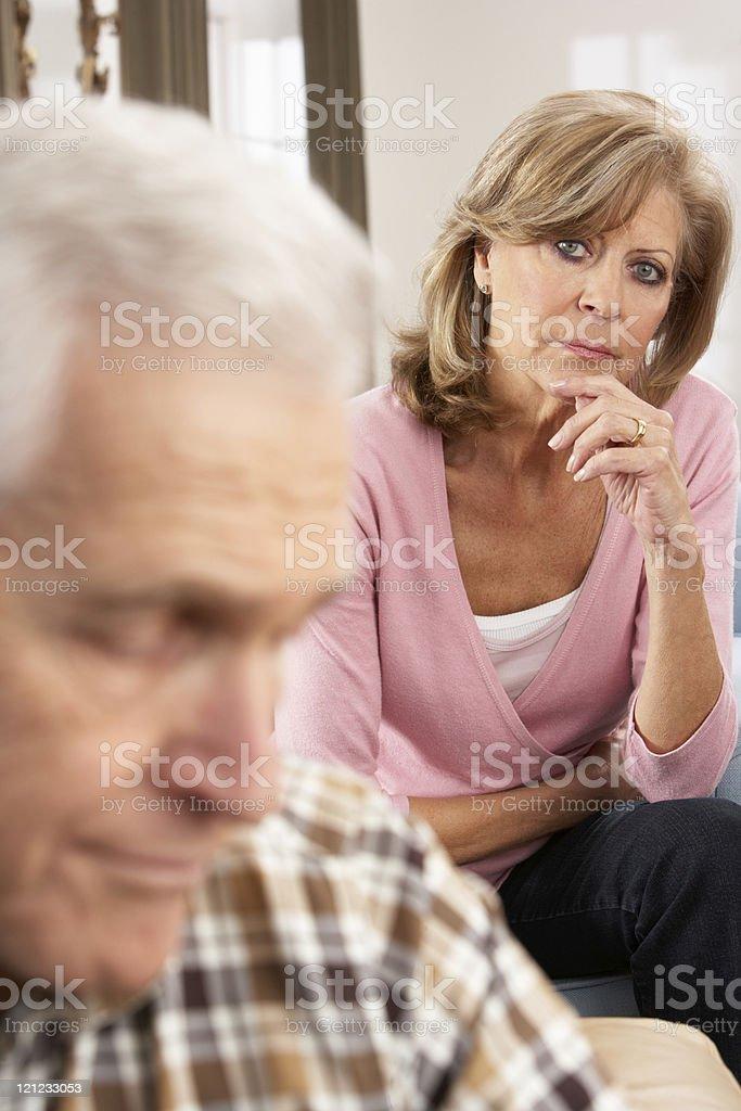 Senior woman looking at her sick husband royalty-free stock photo