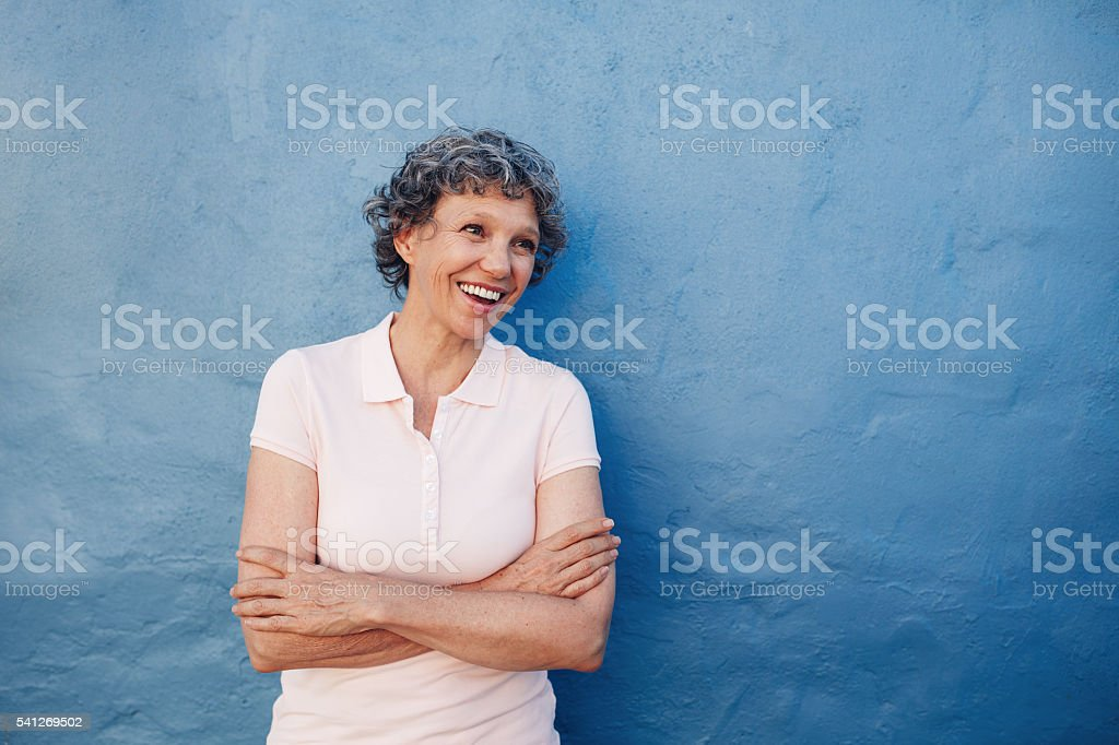 Senior woman looking happily at copy space stock photo