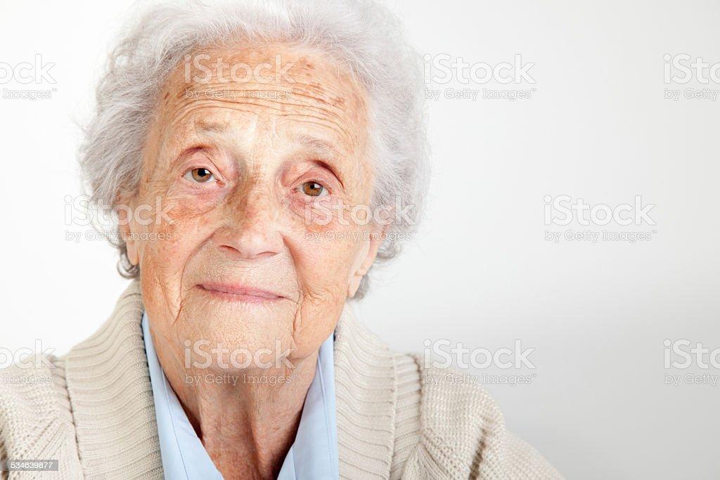 Senior woman looking into camera stock photo