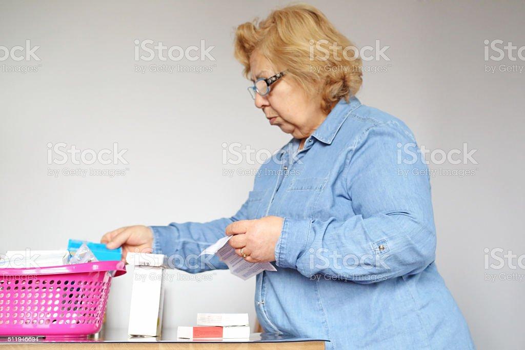 Senior woman looking medicines stock photo