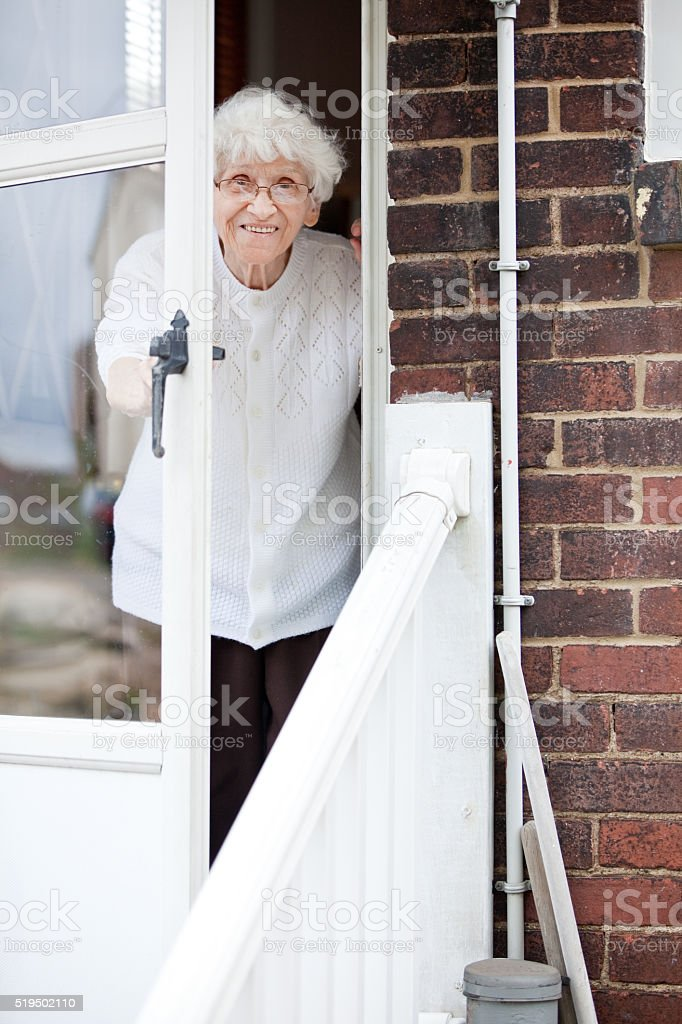 Senior Woman Looking Out Door stock photo