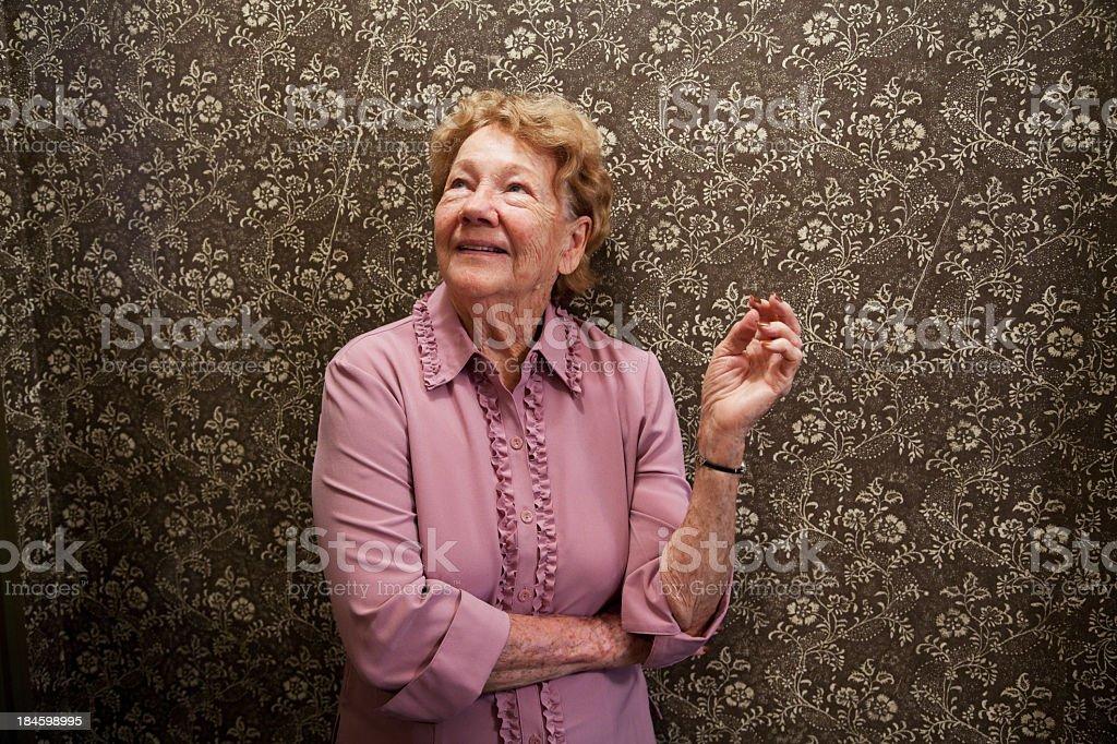Senior woman looking up stock photo