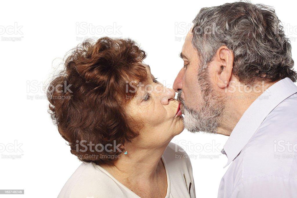 Senior woman, man kiss with close eyes royalty-free stock photo