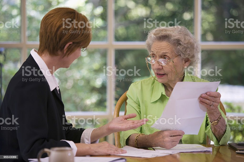 Senior woman meeting with agent stock photo