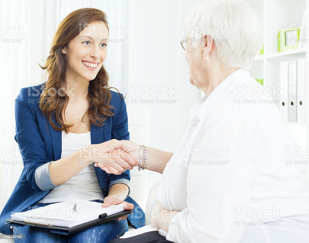 Senior Woman Meeting With Financial Advisor. royalty-free stock photo