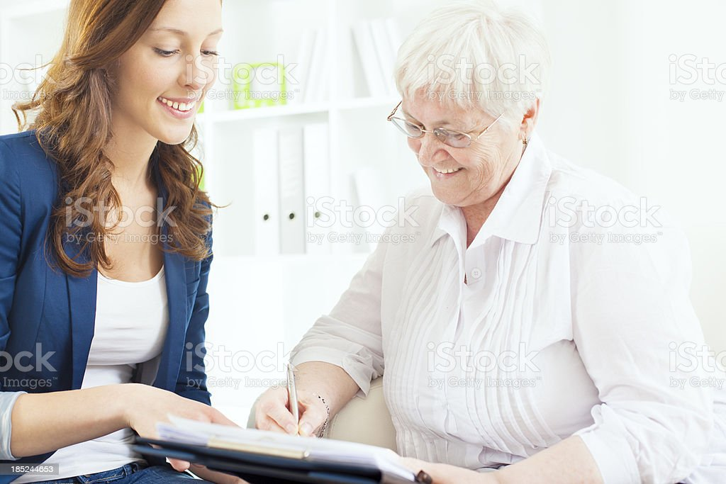 Senior Woman Meeting With Financial Advisor. royalty-free stock photo