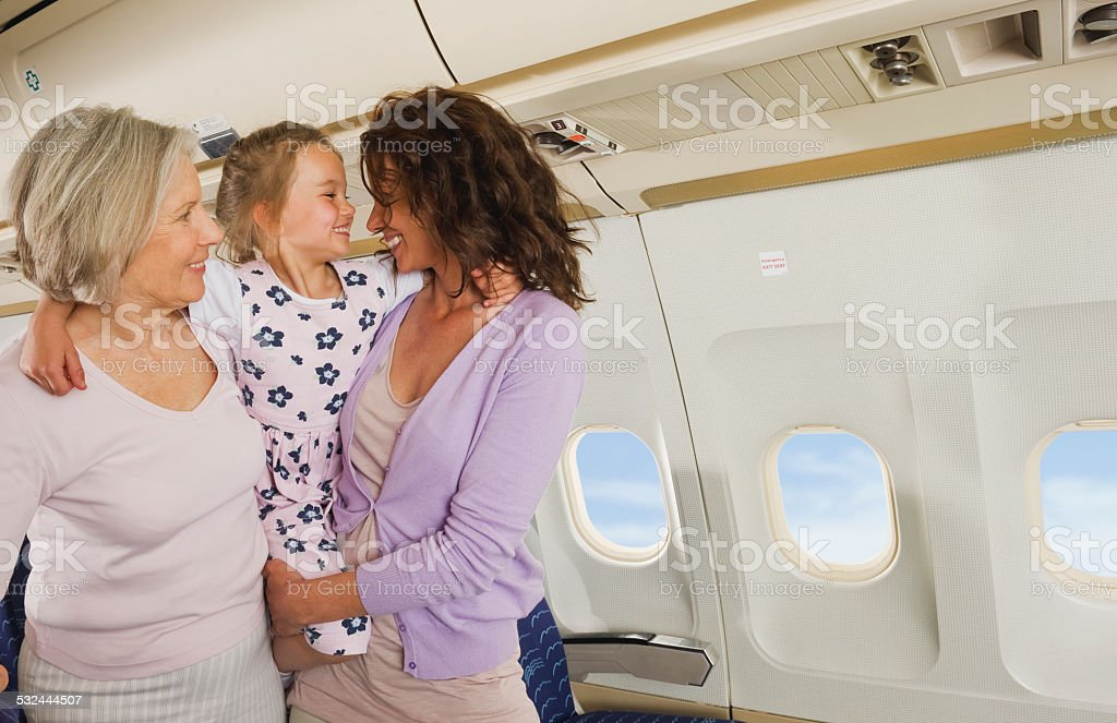 Senior woman mother and girl on airplane stock photo