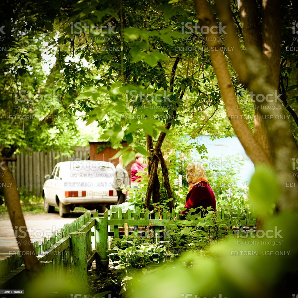 Senior woman near small garden in Zavolzhie stock photo