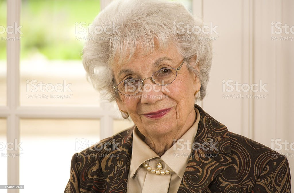 senior woman nicely dressed stock photo