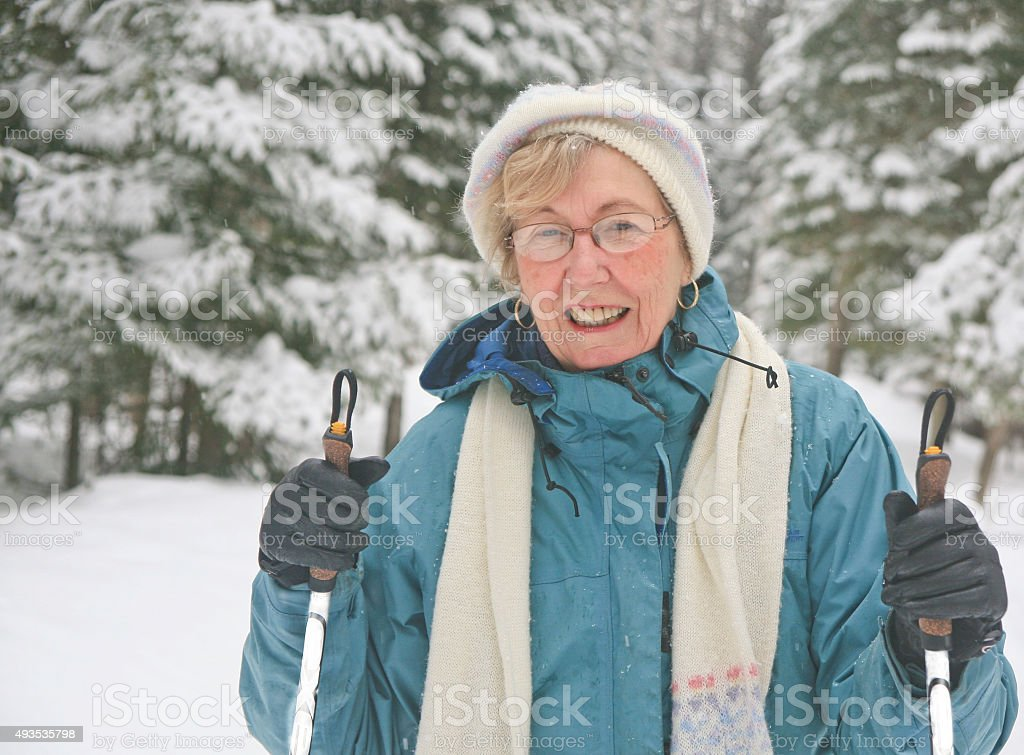 Senior Woman Nordic Skiing stock photo