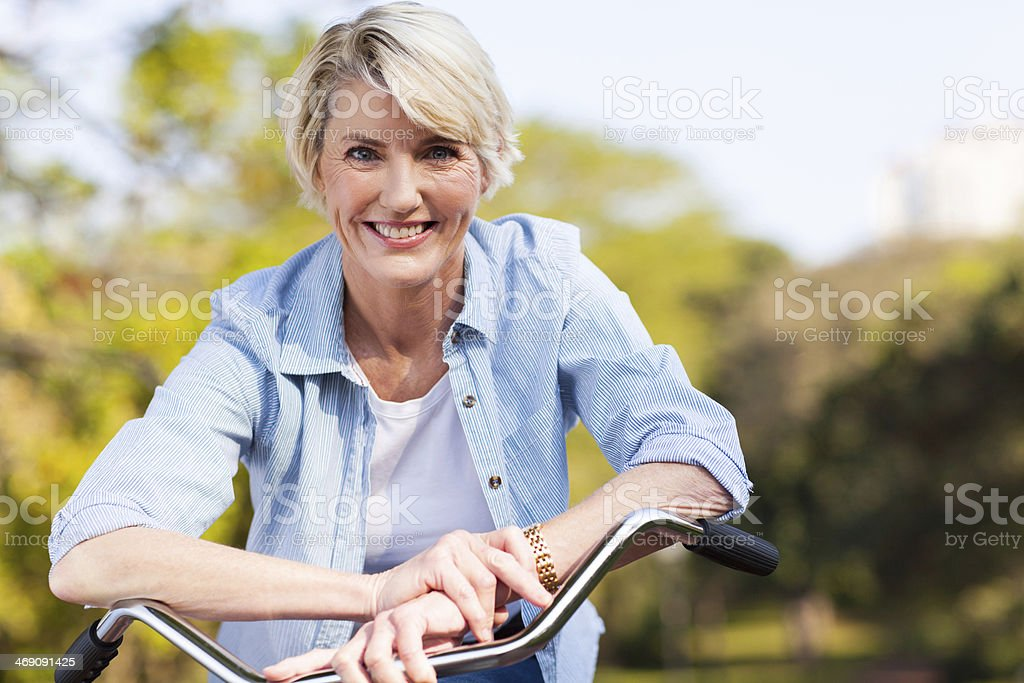 senior woman on a bicycle stock photo