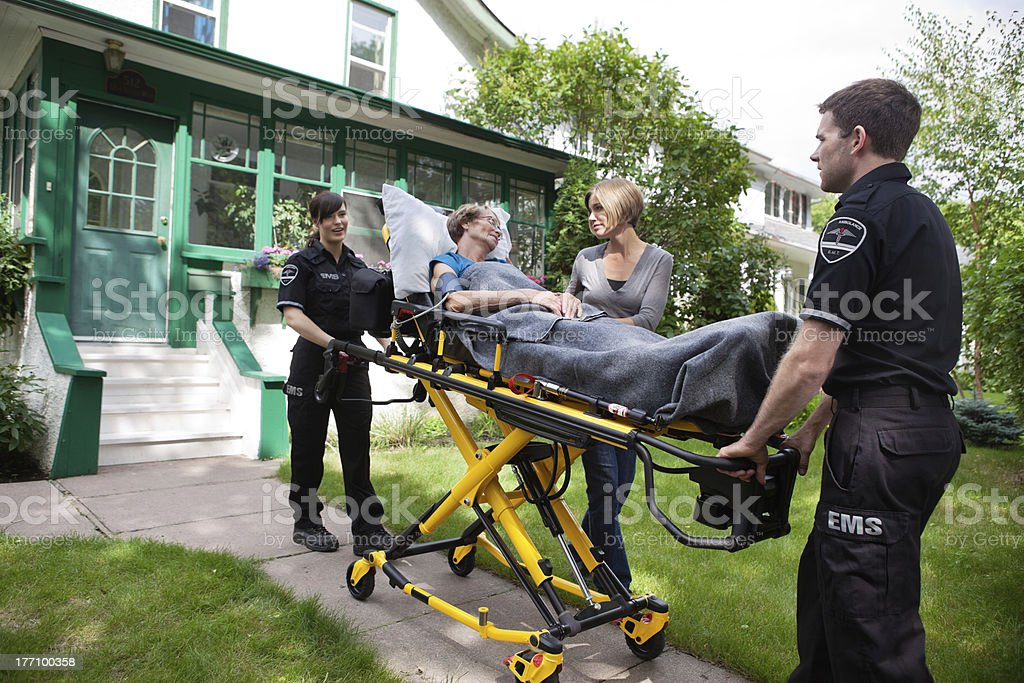 Senior Woman on Ambulance Stretcher stock photo