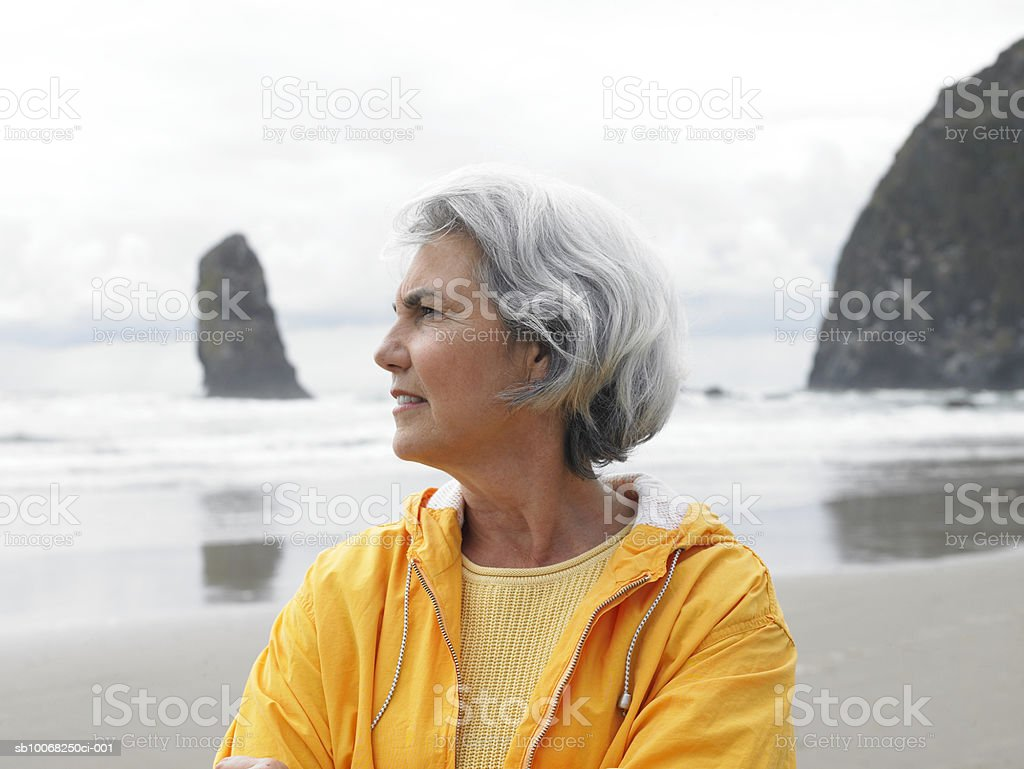 Senior woman on beach stock photo