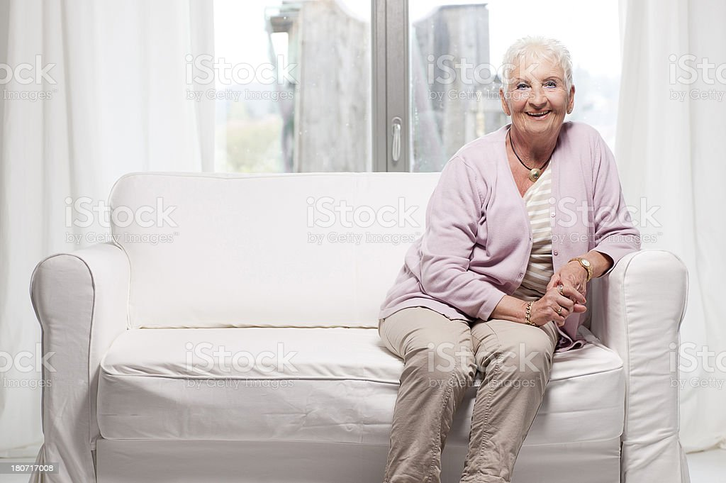 Senior woman on couch royalty-free stock photo