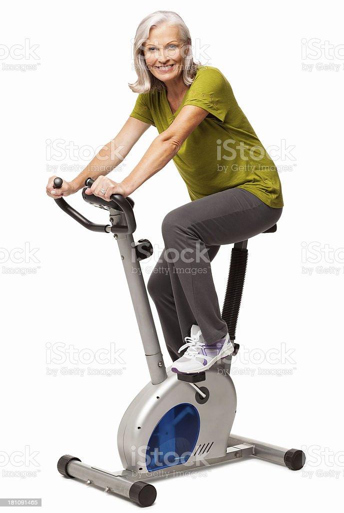Senior Woman on Exercise Bike - Isolated royalty-free stock photo