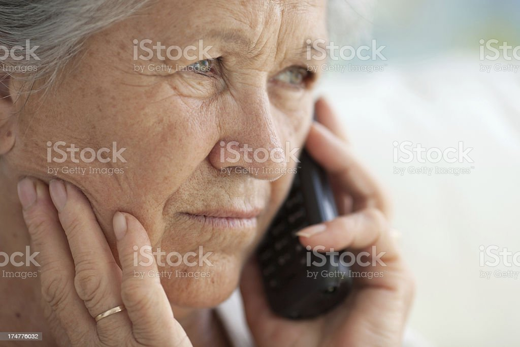 Senior woman on the phone at home royalty-free stock photo