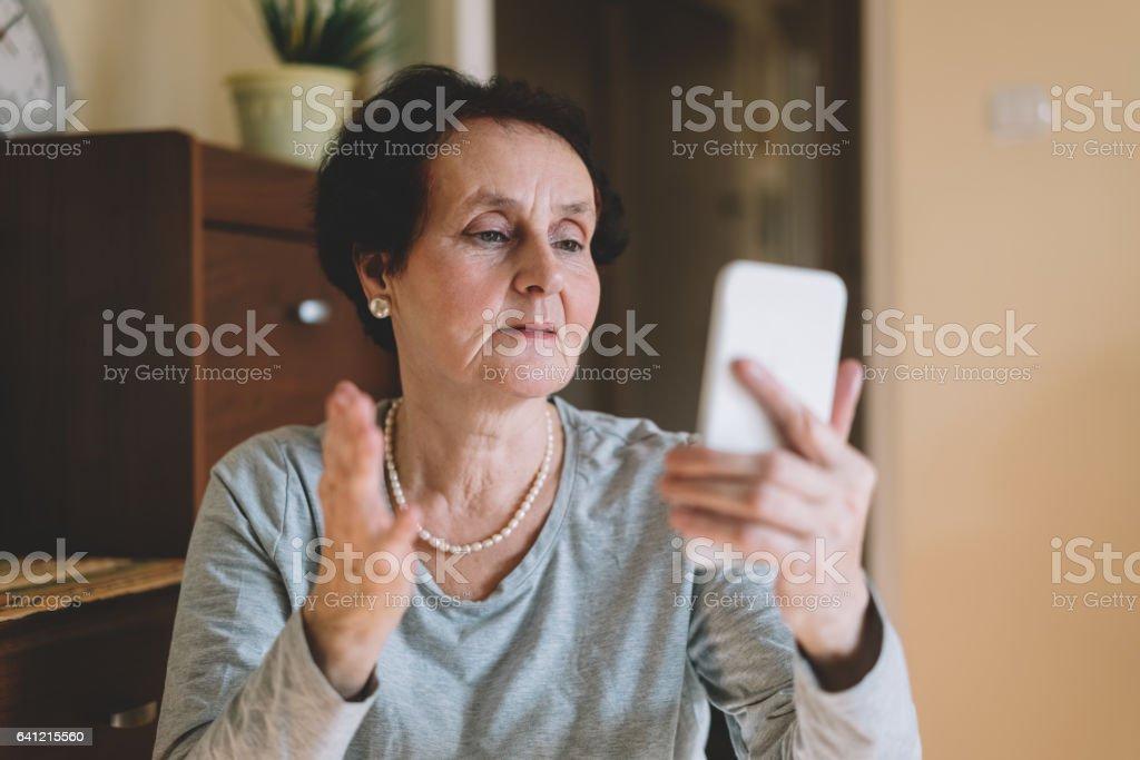 Senior woman on video call stock photo