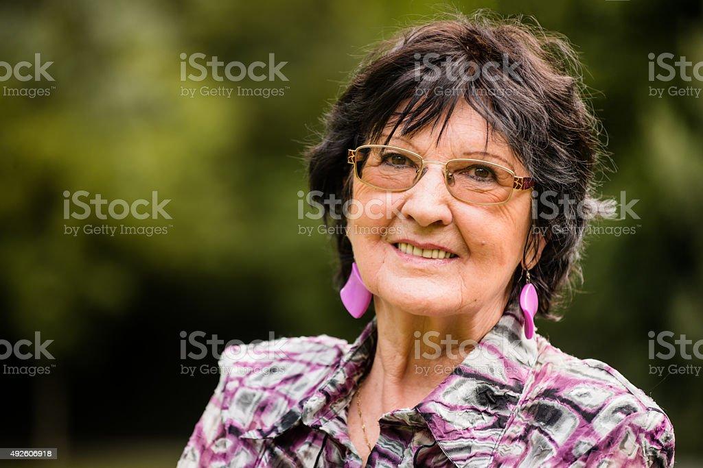 Senior woman outdoor portrait stock photo