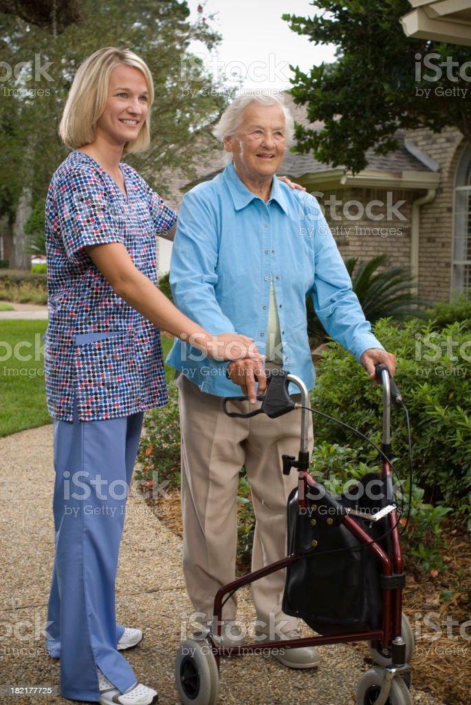 Senior Woman outside a home royalty-free stock photo