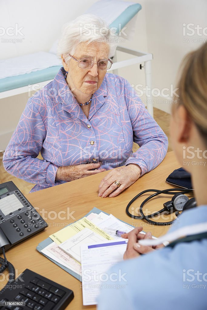 Senior woman patient with UK nurse royalty-free stock photo