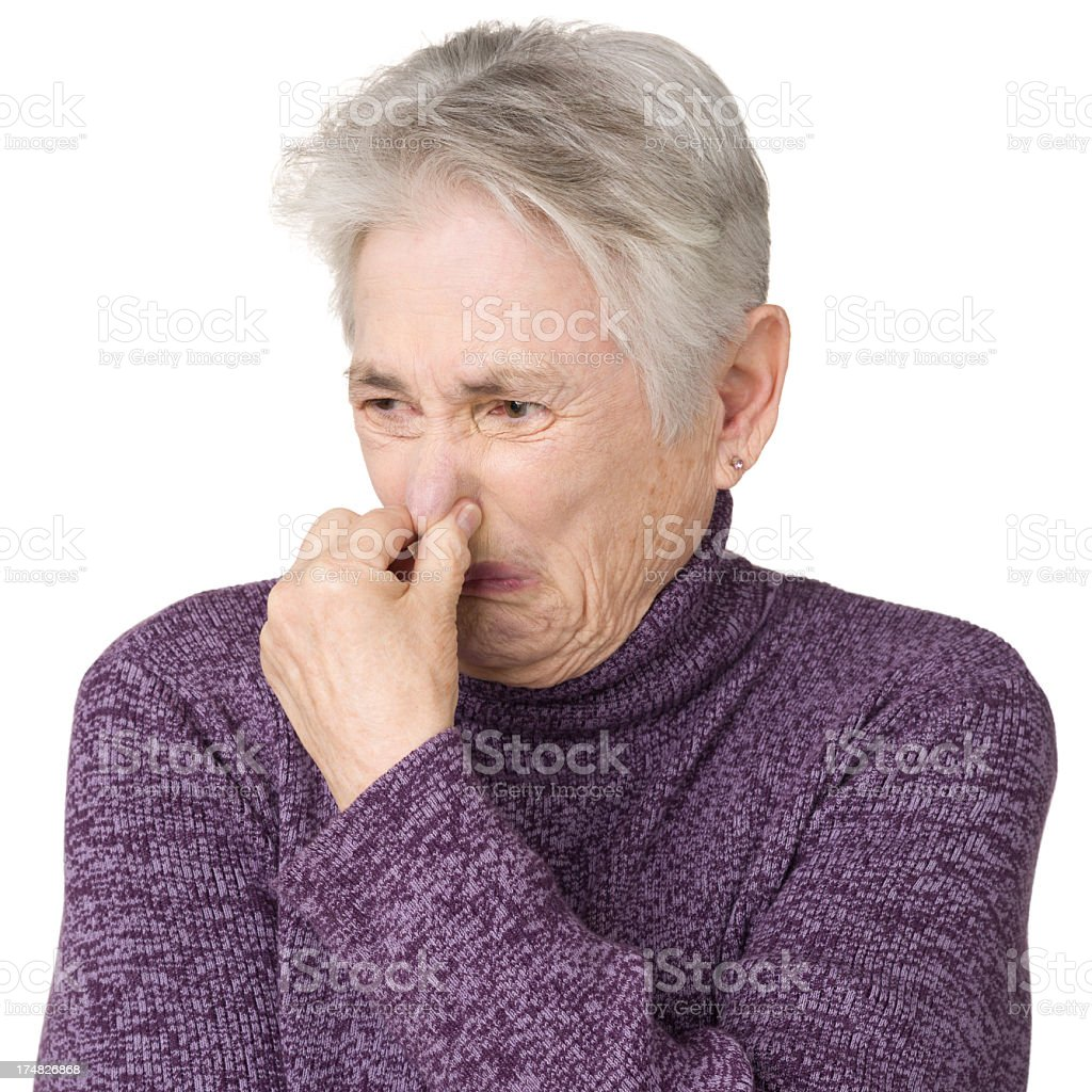 Senior Woman Pinching Nose royalty-free stock photo