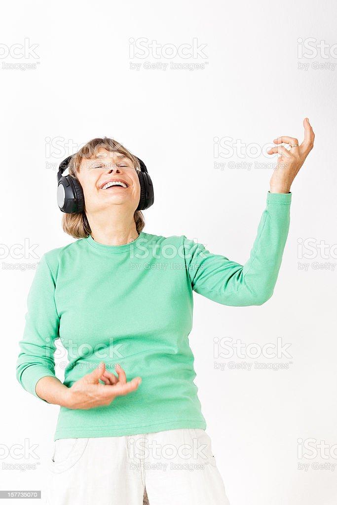 Senior woman playing air guitar royalty-free stock photo