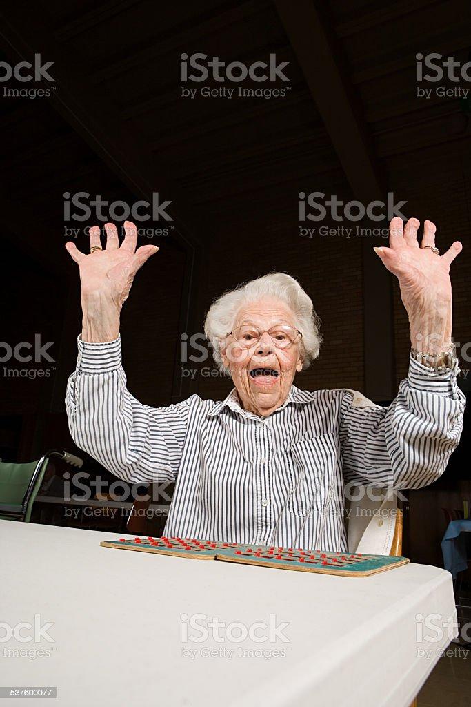 Senior woman playing bingo stock photo