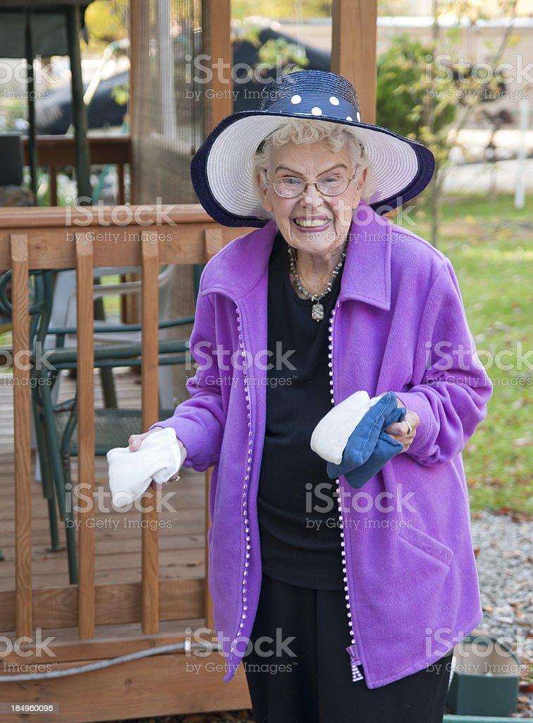 Senior woman playing Cornhole stock photo