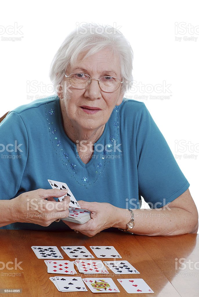 senior woman playing solitaire stock photo