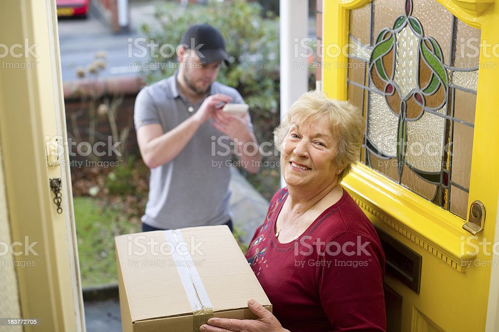 Senior woman pleased with her parcel royalty-free stock photo