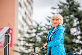 Senior Woman Portrait With Bicycle Outdoor