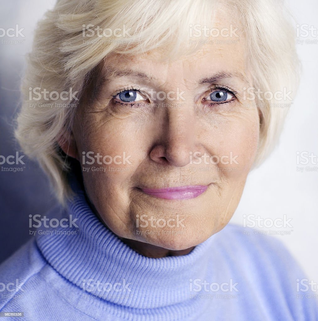 Senior woman portrait with blue pullover stock photo