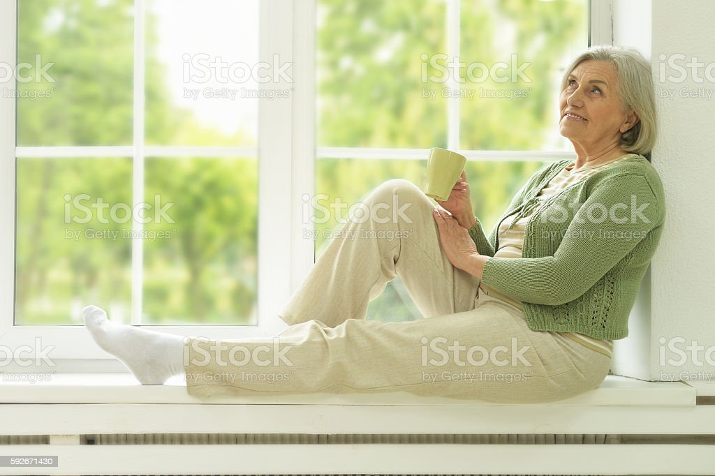 Senior woman portrait with cup of tea stock photo