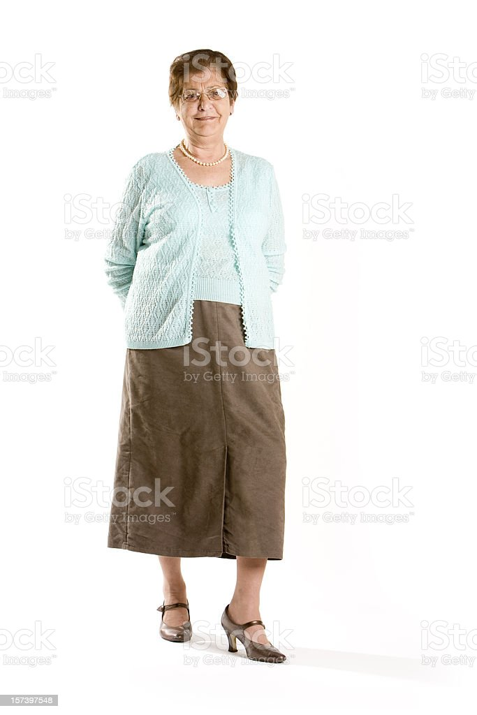 Senior woman posing at the camera against a white background stock photo