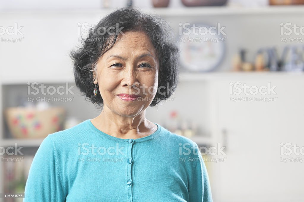 Senior woman posing for the camera stock photo