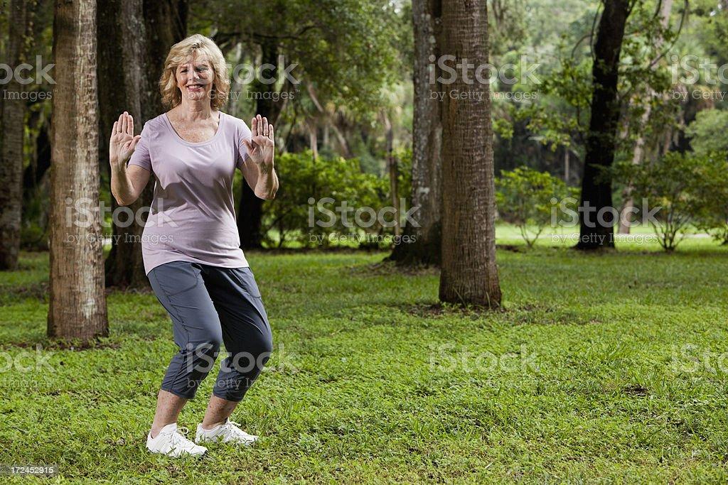 Senior woman practicing tai chi royalty-free stock photo