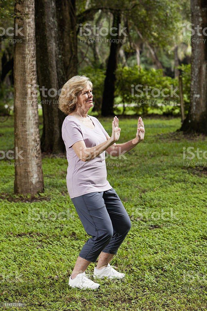 Senior woman practicing tai chi stock photo