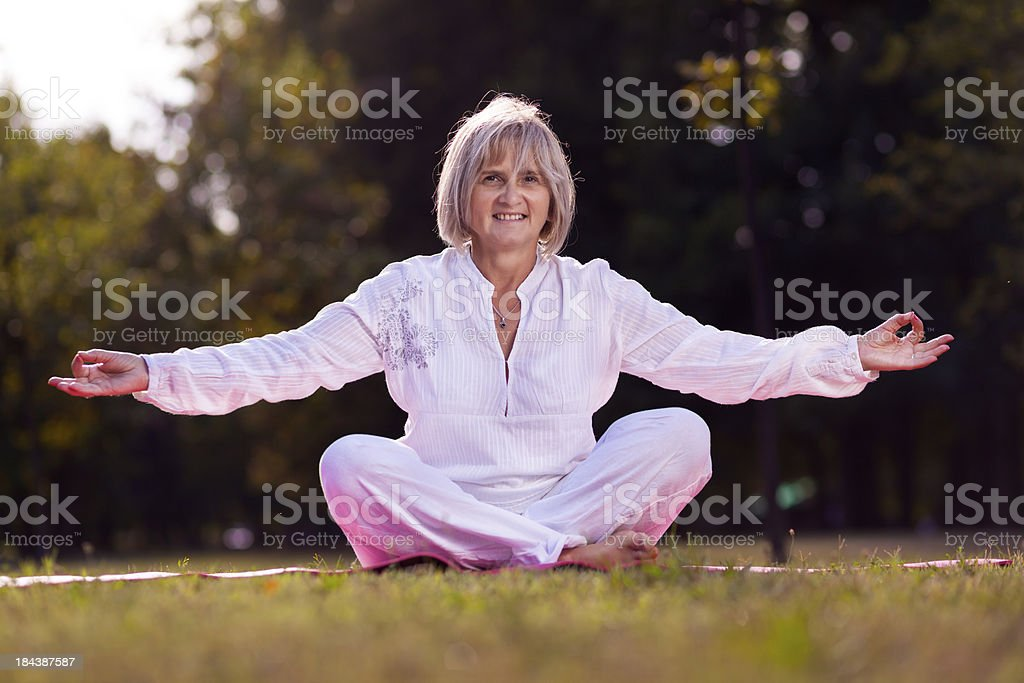 senior woman practicing yoga royalty-free stock photo