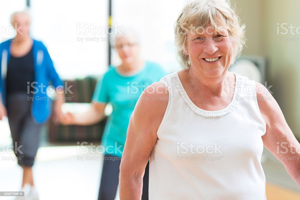 Senior woman prepares to line dance at senior center stock photo