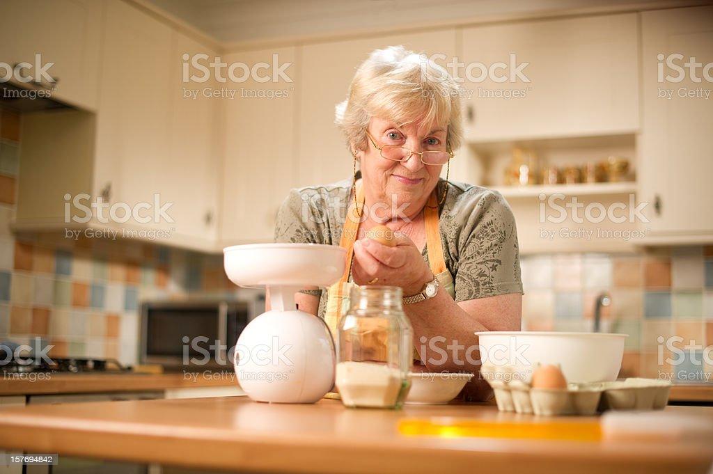 Senior Woman Preparing Food royalty-free stock photo