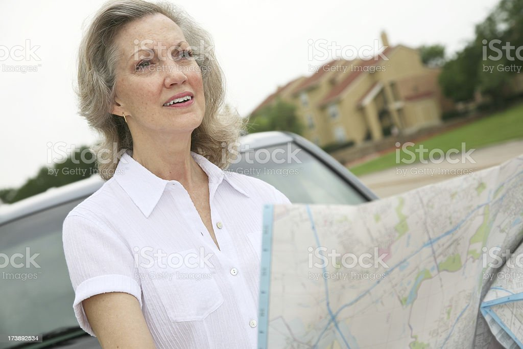 Senior Woman Questioning Where She Is royalty-free stock photo